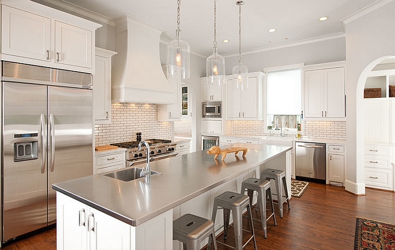 Elegant-kitchen-in-white-with-a-modern-stainless-steel-island