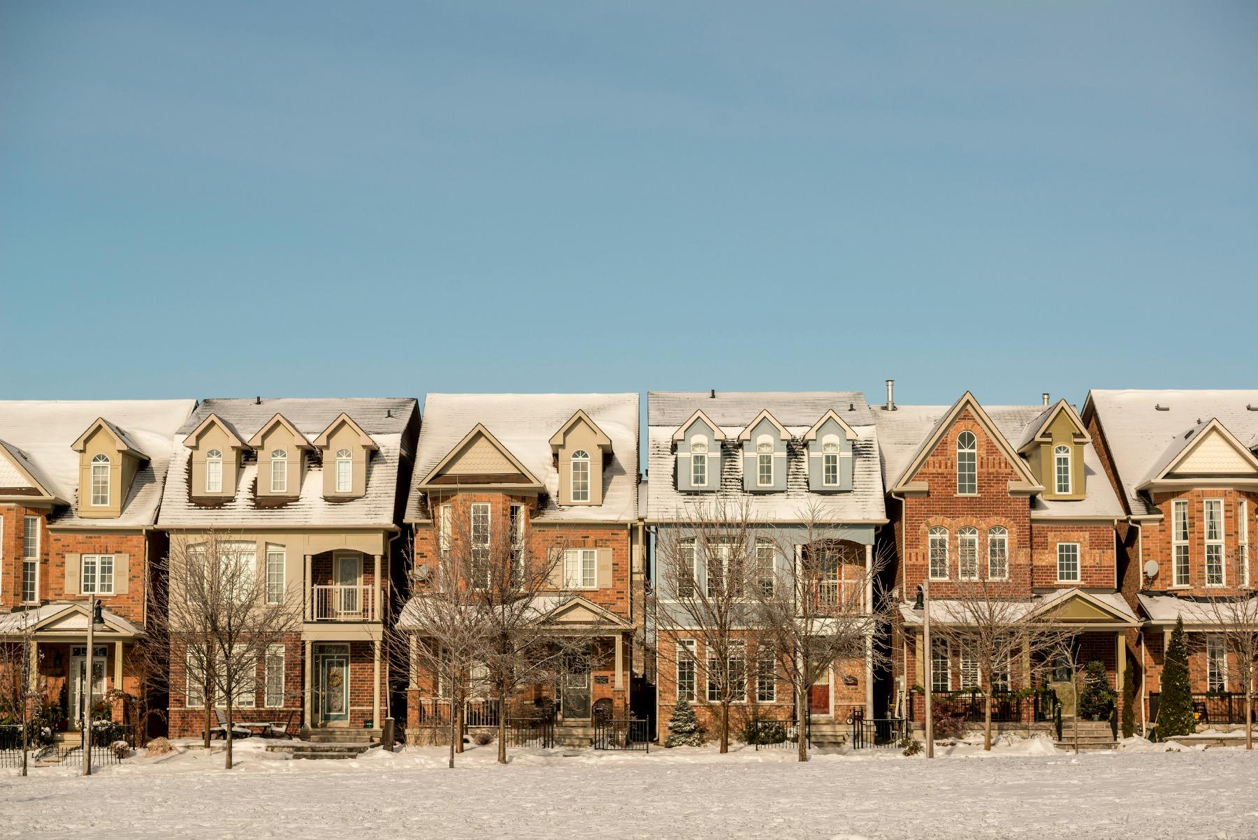 Row of Houses on a Snowy Street